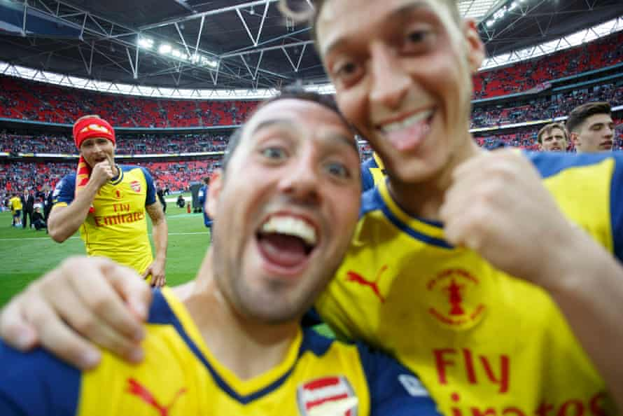 A selfie taken by Santi Cazorla of him and Mesut Ozil with Olivier Giroud watching on.