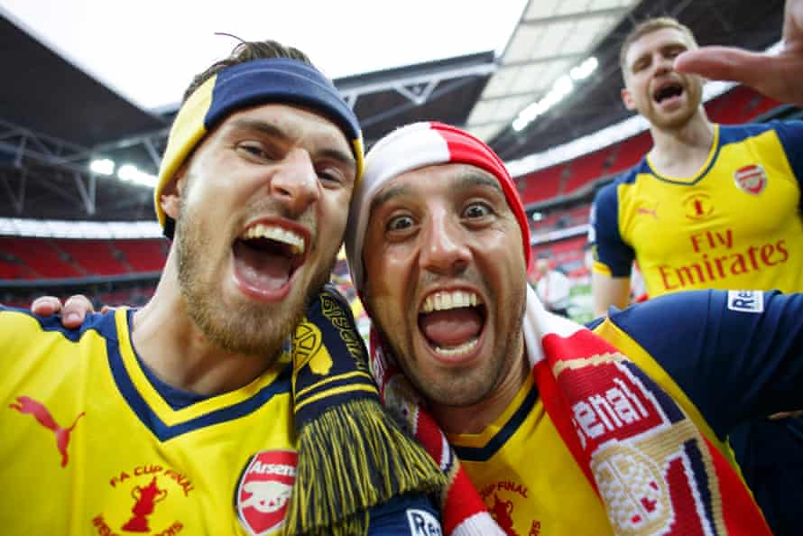 A selfie taken by Aaron Ramsey (left) of him and Santi Cazorla with Per Mertesacker in the background.