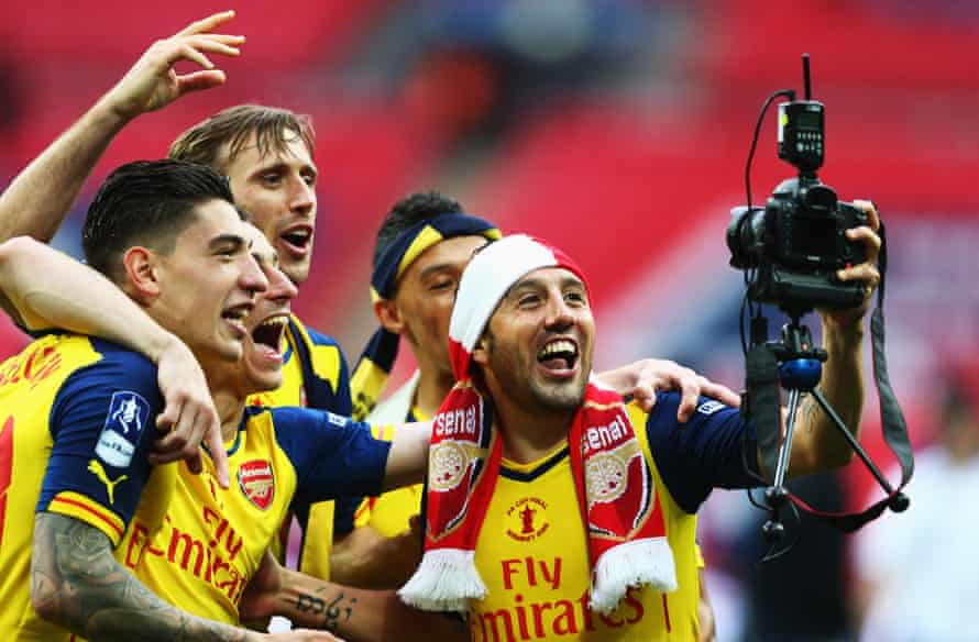 Santi Cazorla use a Tom Jenkins' camera on the Wembley pitch.