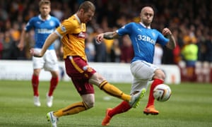 Motherwell's Stephen Pearson challenges Rangers' Nicky Law.