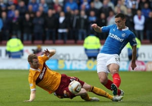 Stephen Pearson challenges Lee Wallace.