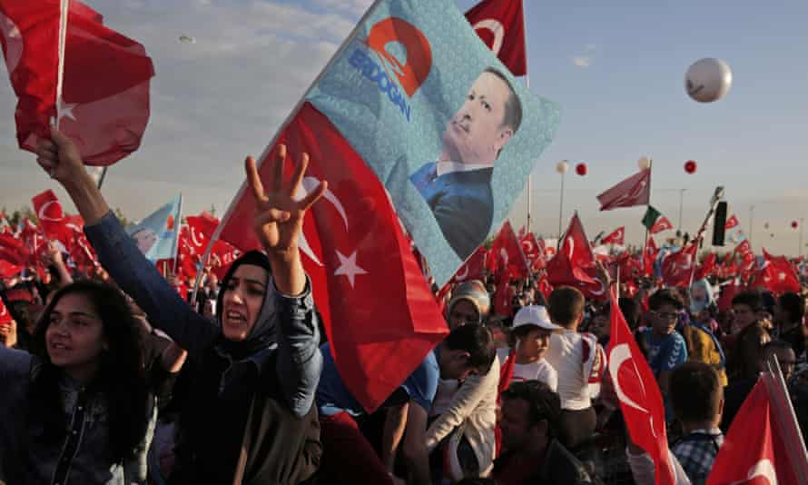Supporters of Recep Tayyip Erdogan wave flags