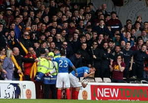Lee McCulloch holds his face.