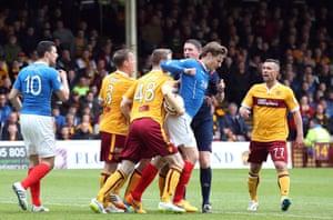 Stephen Pearson clashes with Marius Zaliukas.