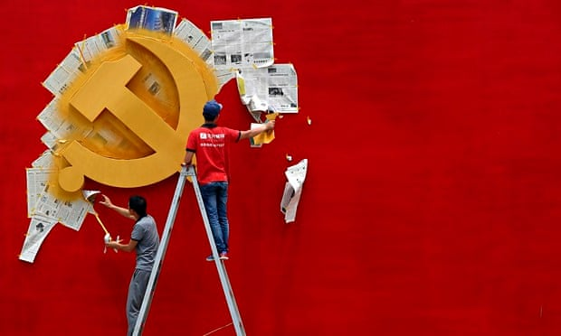 Workers repaint the Chinese Communist party flag in Jiaxing