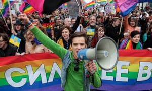 A gay rights activists march during May Day rally in St Petersburg, Russia, in 2014.