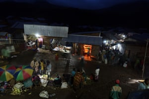 3 April 2015 Numbi, DRC  Numbi bursts into life after dark for a few hours. This is the very heart of the town.  It is dangerous to venture out due to insecurity. One late night prolonged volleys of gunshots echoed dryly ( the sound competing with the brothel action in the next room altogether too audible due to 'walls' made of white coated tarpaulin.)
