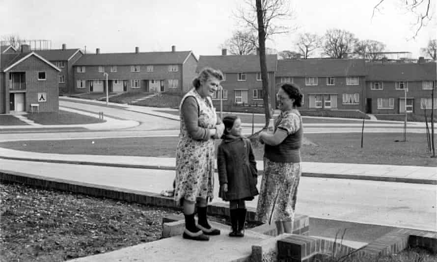 Two women and a child the garden of a council house in the new town of Hemel Hempstead, Hertfordshir