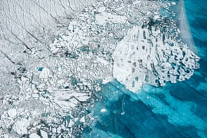 August 19th, 2014.Ilulissat, Greenland Meltwater pools into an unnamed seasonal lake atop the Greenland ice sheet sullied with cryoconite, or soot and ash, 100km southeast of Ilulissat, August, 2014.