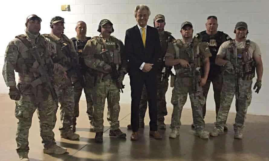 Geert Wilders with police at Garland