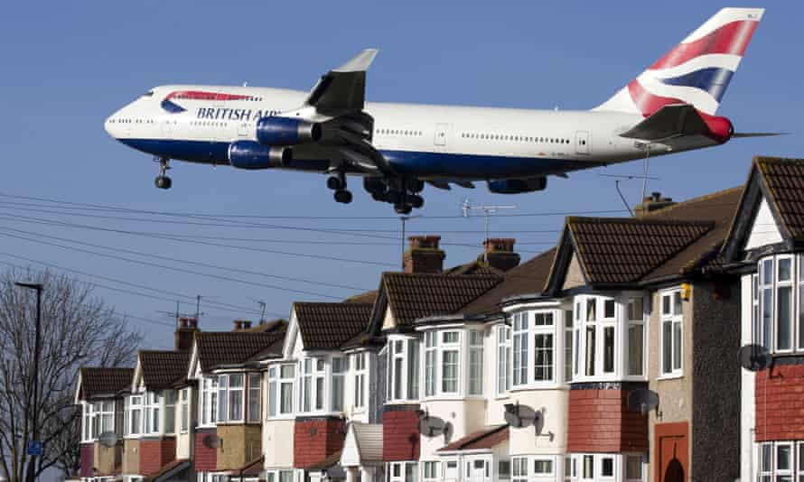 A British Airways 747 aircraft flies over rooftops as it comes in to land at Heathrow airport.