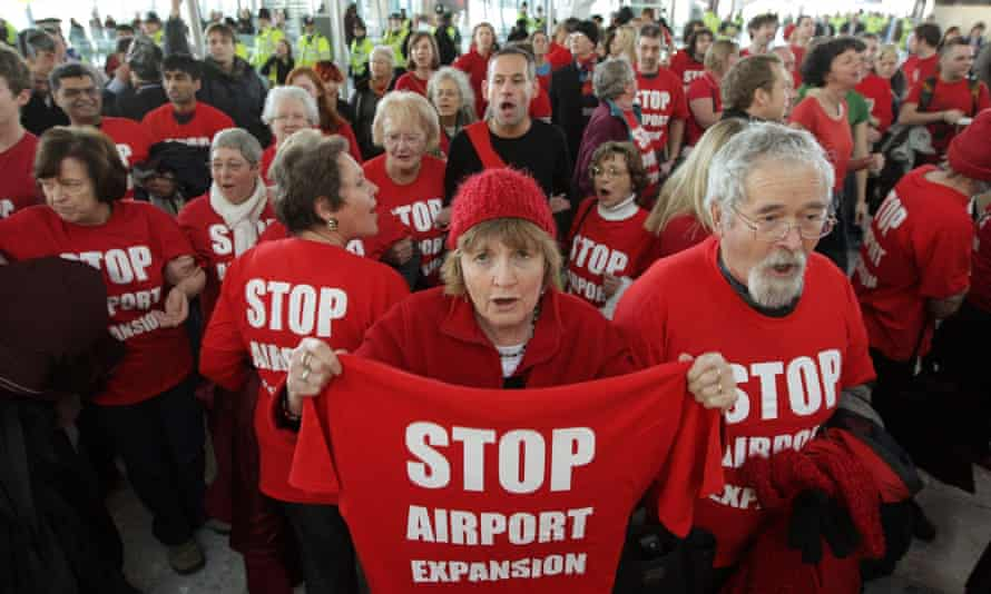 Anti-expansion protesters gather at Heathrow Terminal 5.