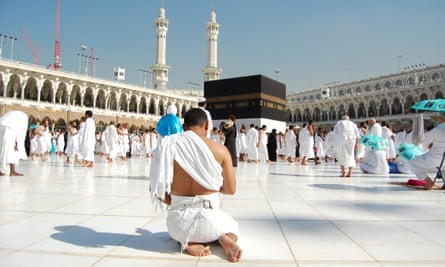 A pilgrim deep in prayer at the Kaaba in Mecca.
