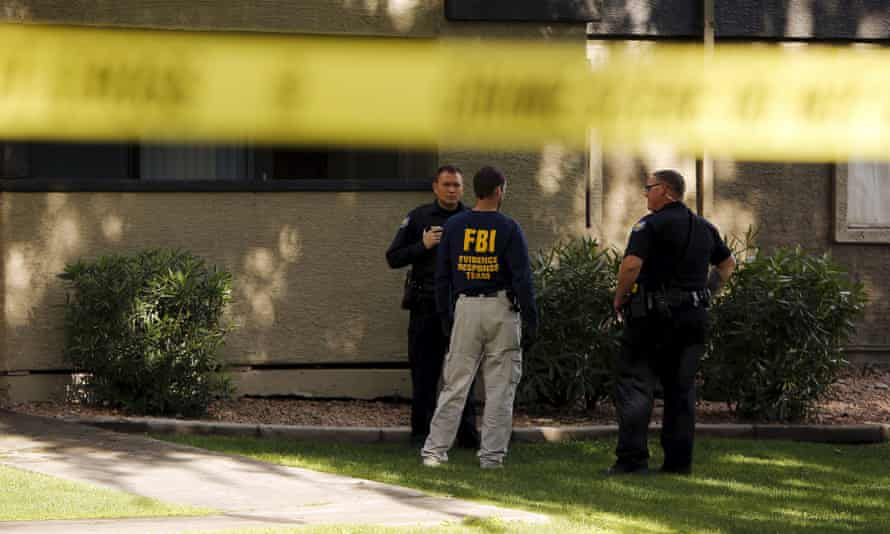 Law enforcement officers at the Autumn Ridge apartment complex searched by investigators in Phoenix, Arizona, after two gunmen were shot dead at an exhibit of caricatures of the Prophet Mohammad.