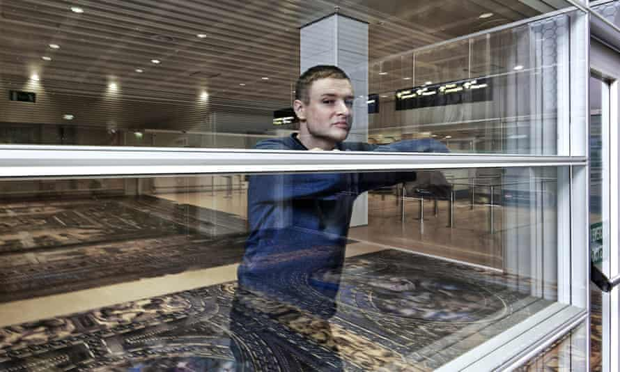 Simon Denny with his installation titled Secret Power at Marco Polo Airport, as part of Venice Biennale 2015