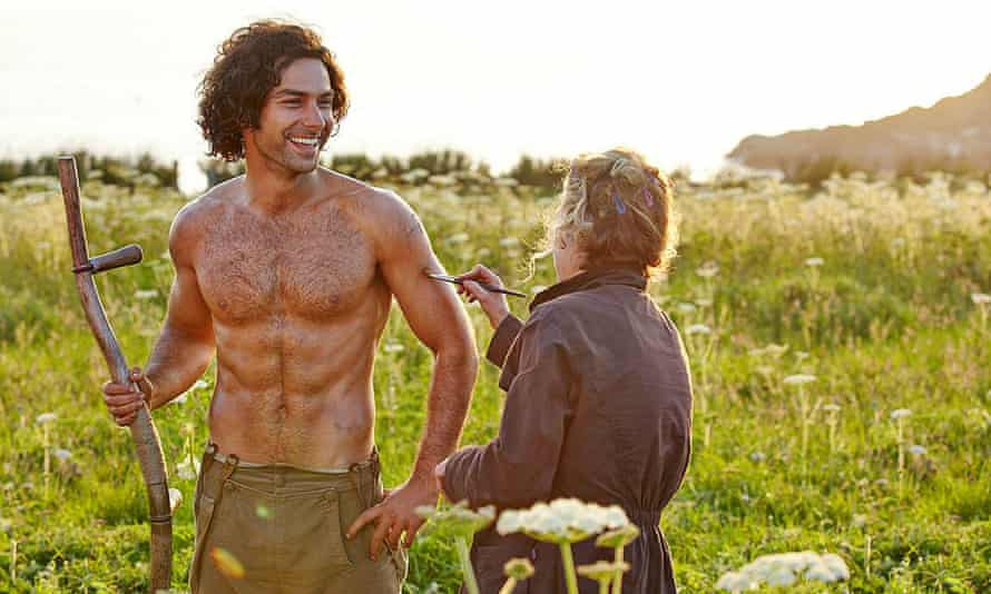 Aidan Turner is seen topless and muscly during  filming of Poldark