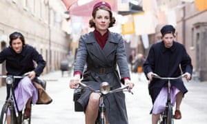 Jessica Raine (centre) as Jenny Lee in Call the Midwife, riding a pushbike