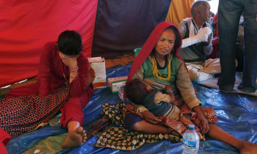 People injured in last month's earthquake rest inside a tent at a makeshift hospital in Chautara, Sindhupalchok district, Nepal.