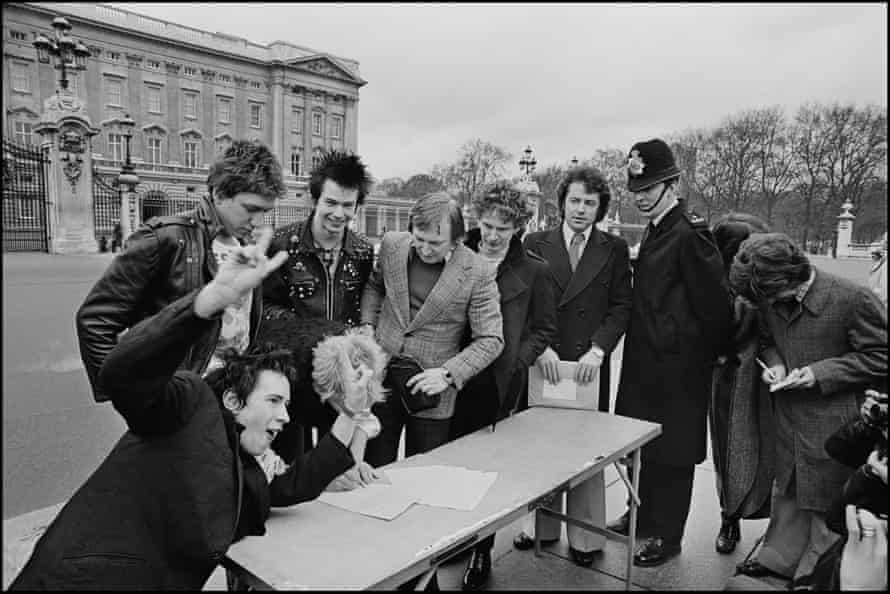 The Sex Pistols sign their record deal outside Buckingham Palace in 1977, captured by Chalkie Davies