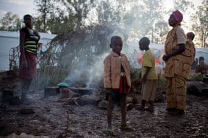 Refugees cook a meal of boiled corn and beans. Unrest has spread since President Pierre Nkurunziza declared he would stand for a third term, with intimidation by pro-government youth militia driving thousands from their homes.