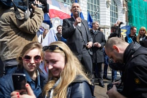 Audience members take a selfie while Janusz Korwin-Mikke gives a campaign speech to supporters in Gdańsk, Poland.