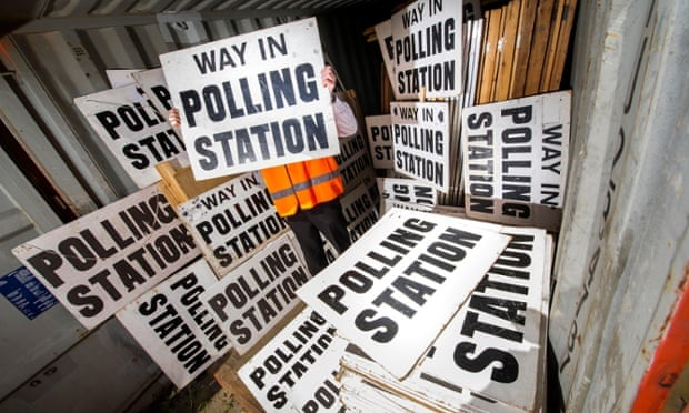 a council official sorts through polling signs and booths in Devon, in preparation for the General Election on the 7th May 2015.