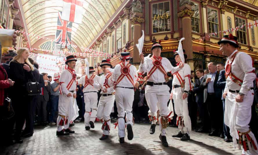 Traditional Morris Men jig in the undervover Leadenhall Market in the City of London, on England's national St George's Day the 23rd April