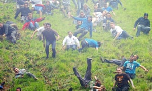 Competitors during the annual Cheese Rolling competition at Coopers Hill near Browckworth, Gloucestershire