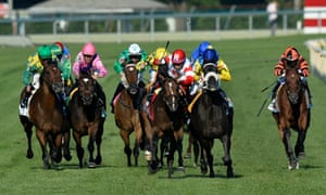 The Apache, ridden by Christophe Soumillon (10), impedes Real Solution, center, ridden by Alan Garcia, as they run toward the finish during the Arlington Million horse race on Saturday, Aug. 17, 2013, in Arlington Heights, Ill. The Apache was disqualified for the foul and Real Solution was ruled the winner.  (AP Photo/Brian Kersey)