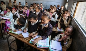 Egyptian students at a primary school in Giza, Egypt. The school's headteacher complains that class sizes can reach up to 70 pupils.