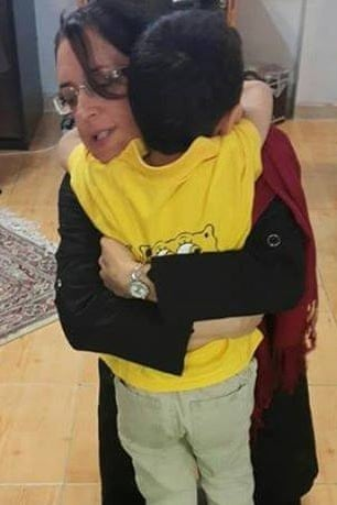 Faran Hesami embraces her son before returning to prison after a four-day leave this March. She is a Bahá'í