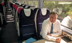 Ed Balls on his way to a factory in Cardiff.