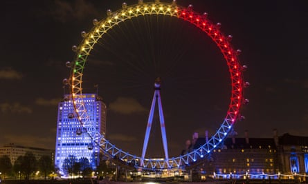 London Eye lit up with colours of political parties.