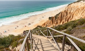 Wooden staircase in the sandstone cliffs at Comporta, Portugal