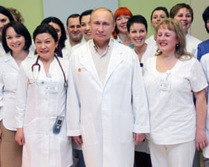 Vladimir Putin visits a maternity hospital in Lapino, near Moscow.