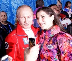 Vladimir Putin poses with a fan
