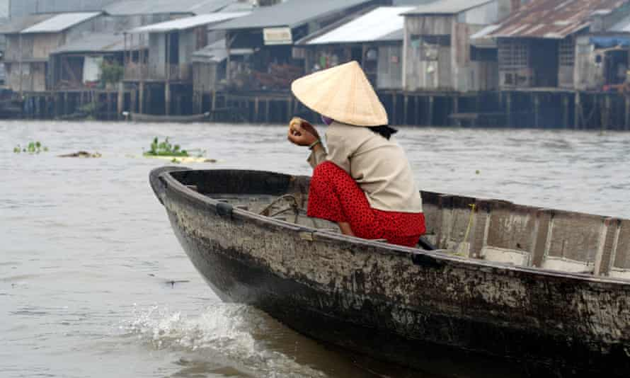 Woman on a boat on the Mekong River