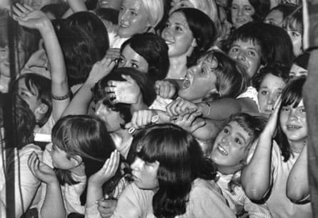 14th August 1964:  Rolling Stones fans watching the band in concert at the Wimbledon Palais, London.