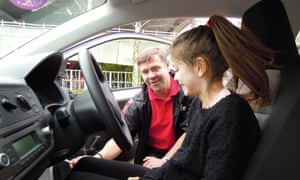 Now, those are the pedals: instructor Gary patiently talks Mary through her foot controls.