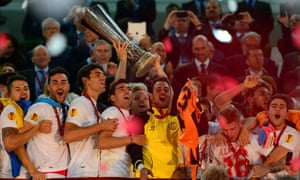 Ivan Rakitic of Sevilla lifts the Europa League trophy  after their win over Benfica at the Juventus Stadium last year.