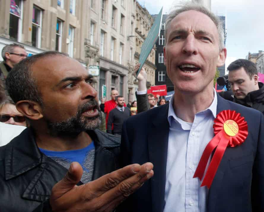 Scottish Labour leader Jim Murphy is confronted by a protester