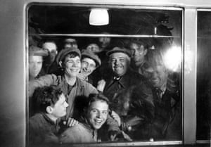After the completion of Moscow's first underground line, workers take the first ride in the new train, 1935