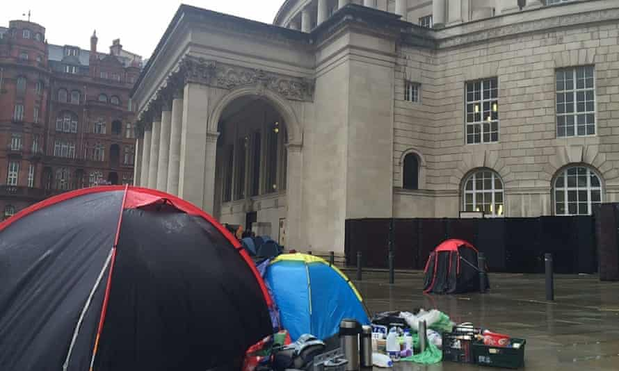 Homeless people in Manchester have set up camp outside the town hall and Central Library to demand housing