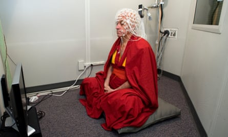 In the zone: Matthieu Ricard, Buddhist monk and 'world's happiest person', wears a geodesic sensor net.
