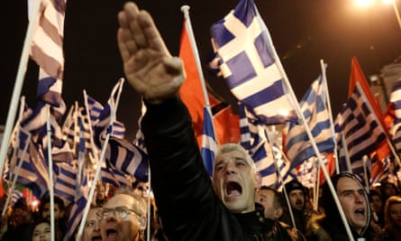 A supporter of Greece's extreme right party Golden Dawn gives a Nazi salute during a rally in Athens.