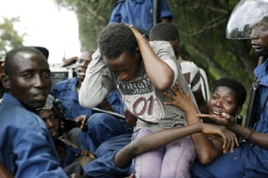 Demonstrators are detained in a police vehicle during clashes in Bujumbura
