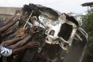 A burnt out car is used to block the road
