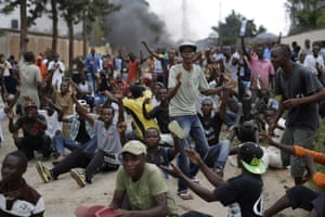 Demonstrators chant anti government slogans in front of riot police in Bujumbura