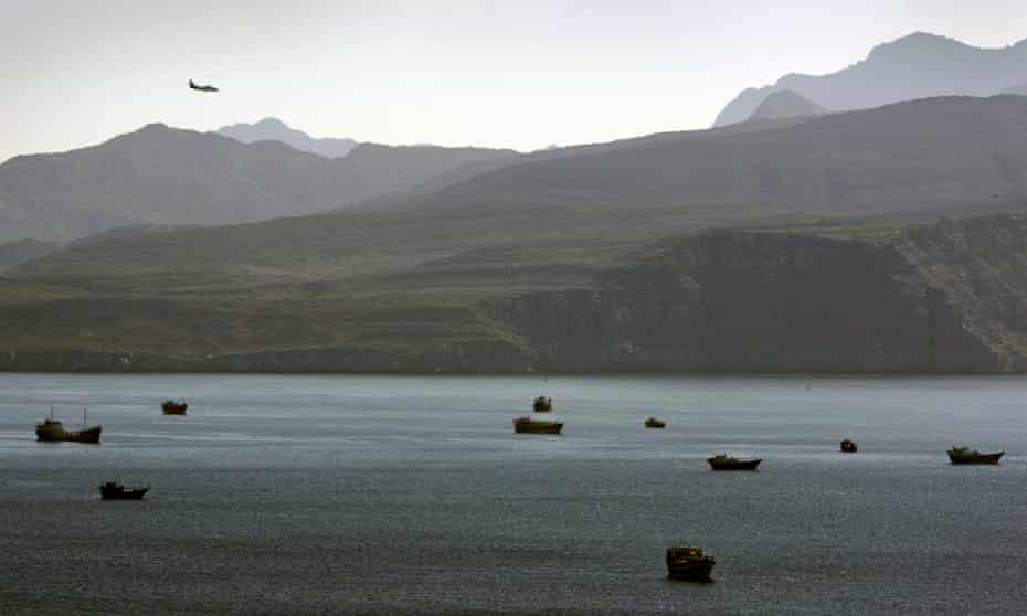 A plane flies over the mountains in the south of the strait of Hormuz, a crucial waterway in the oil trade.