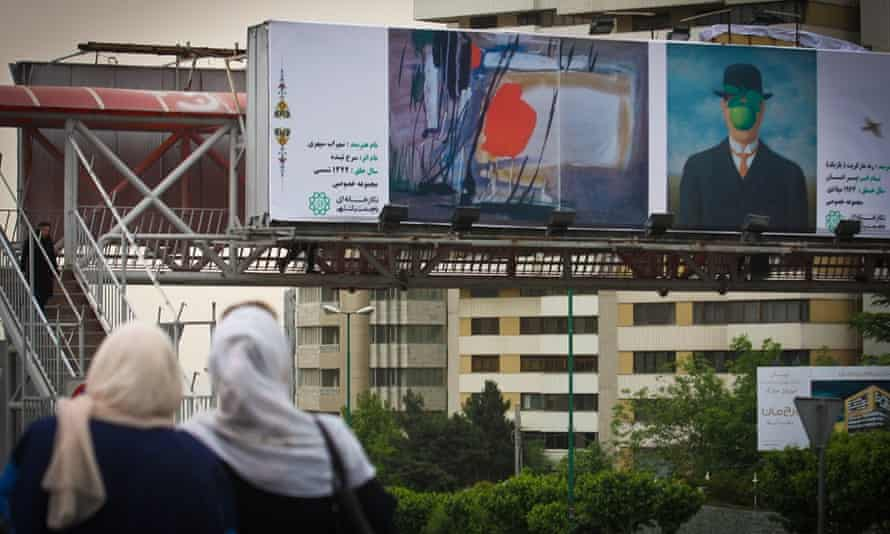 A Tehran street billboard shows The Son of Man next to a painting by Sohrab Sepehri